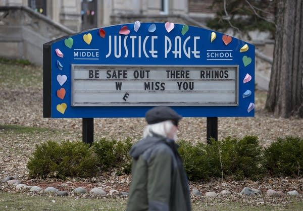 "A marquee at a school reads ""Be safe out there, rhinos. We miss you."""
