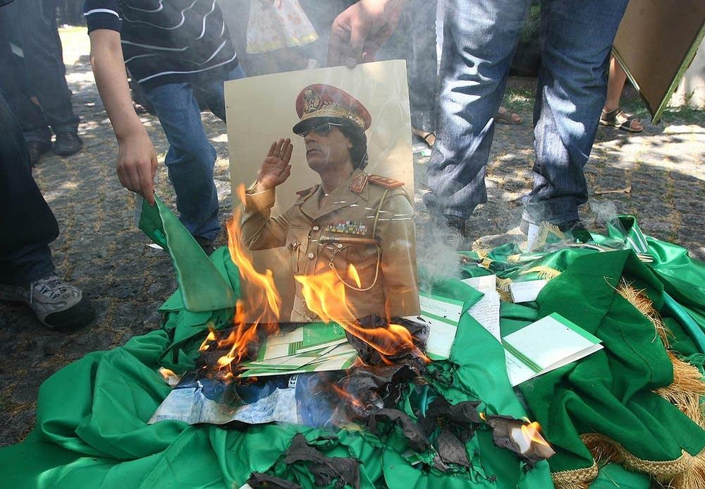 Portrait of Moammar Gadhafi burns