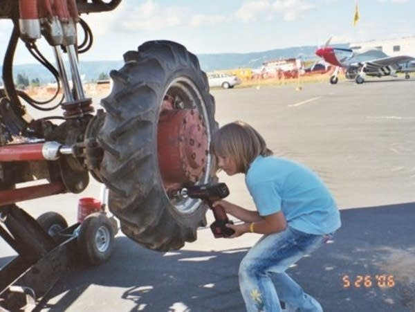Nine-year-old Rosalee Ramer working on a monster truck in 2006.