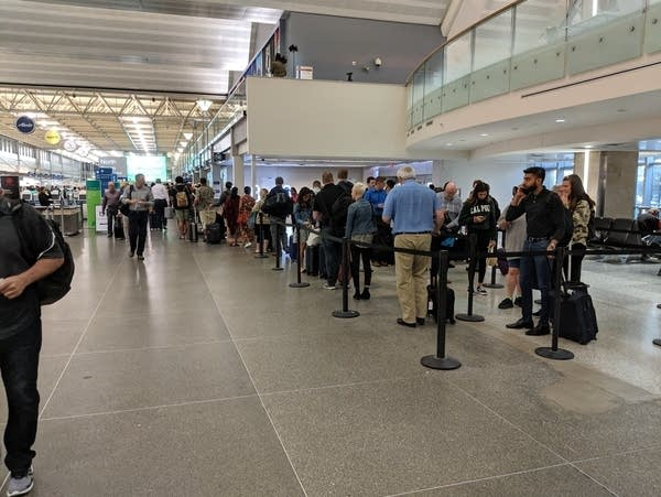 Travelers at the north security checkpoint at MSP airport