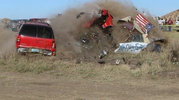 A car crashes while attempting a jump