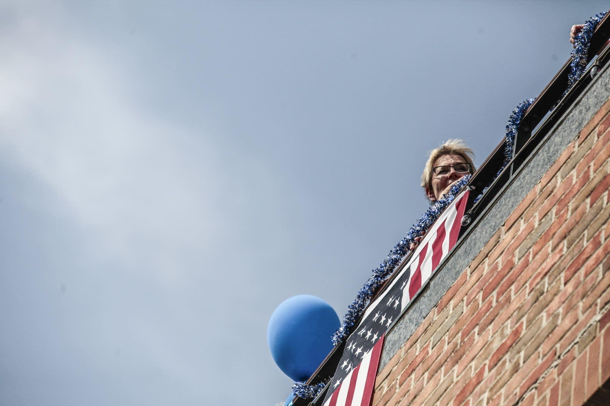 A woman watches the procession pass through Wayzata.