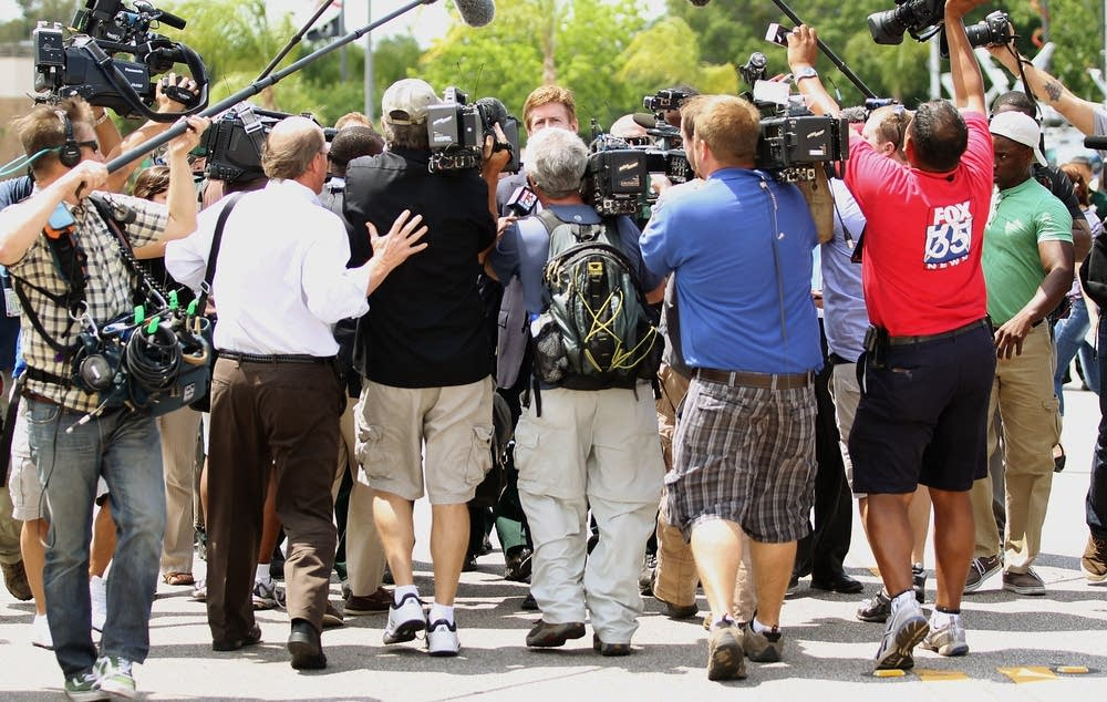 Zimmerman attorney Mark O'Mara surrounded
