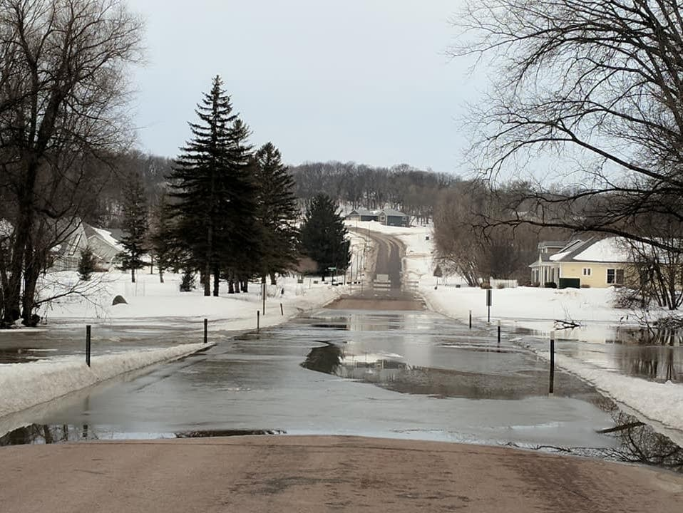 Cottonwood Street in New Ulm, Minn., is closed by floodwaters