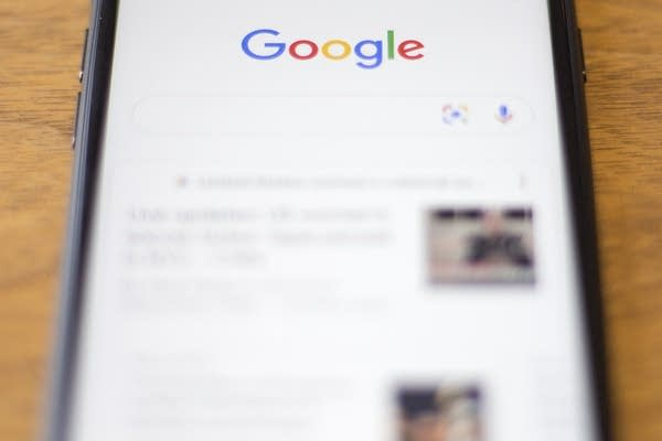 The Google logo on a phone.