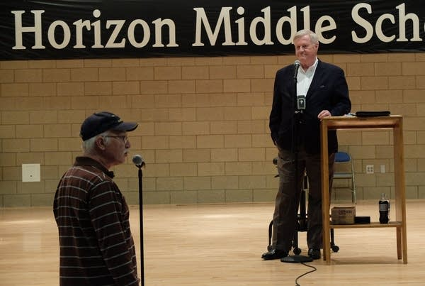 7th District U.S. Rep. Collin Peterson listens to Tom Ebacher