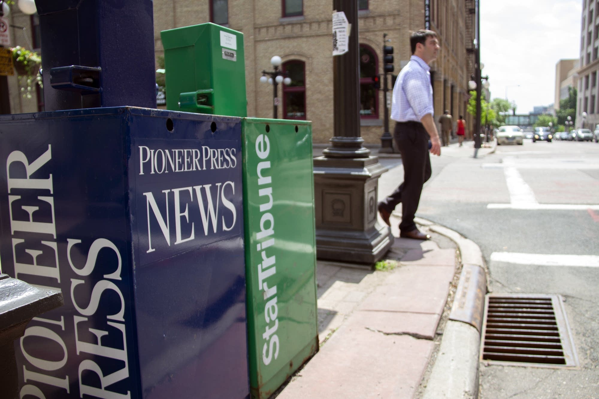 Newspaper boxes sit on a corner in Mears Park in St. Paul.