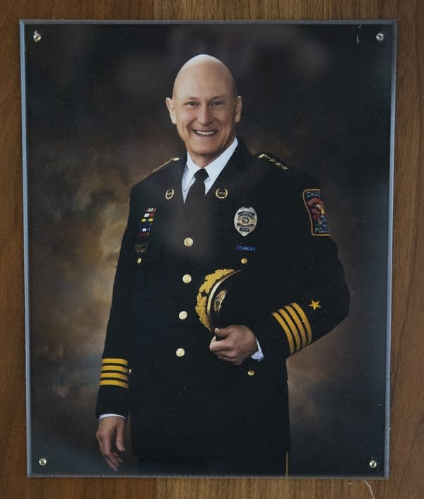 A photograph of a man wearing a police uniform