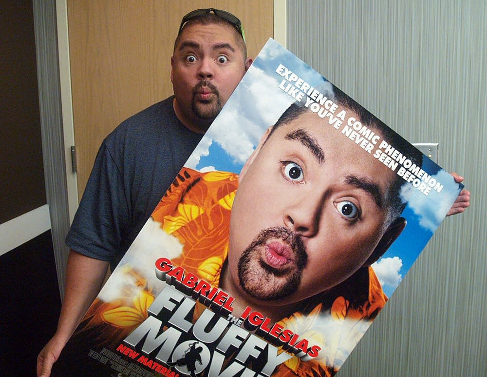 Iglesias clowns around with his movie poster