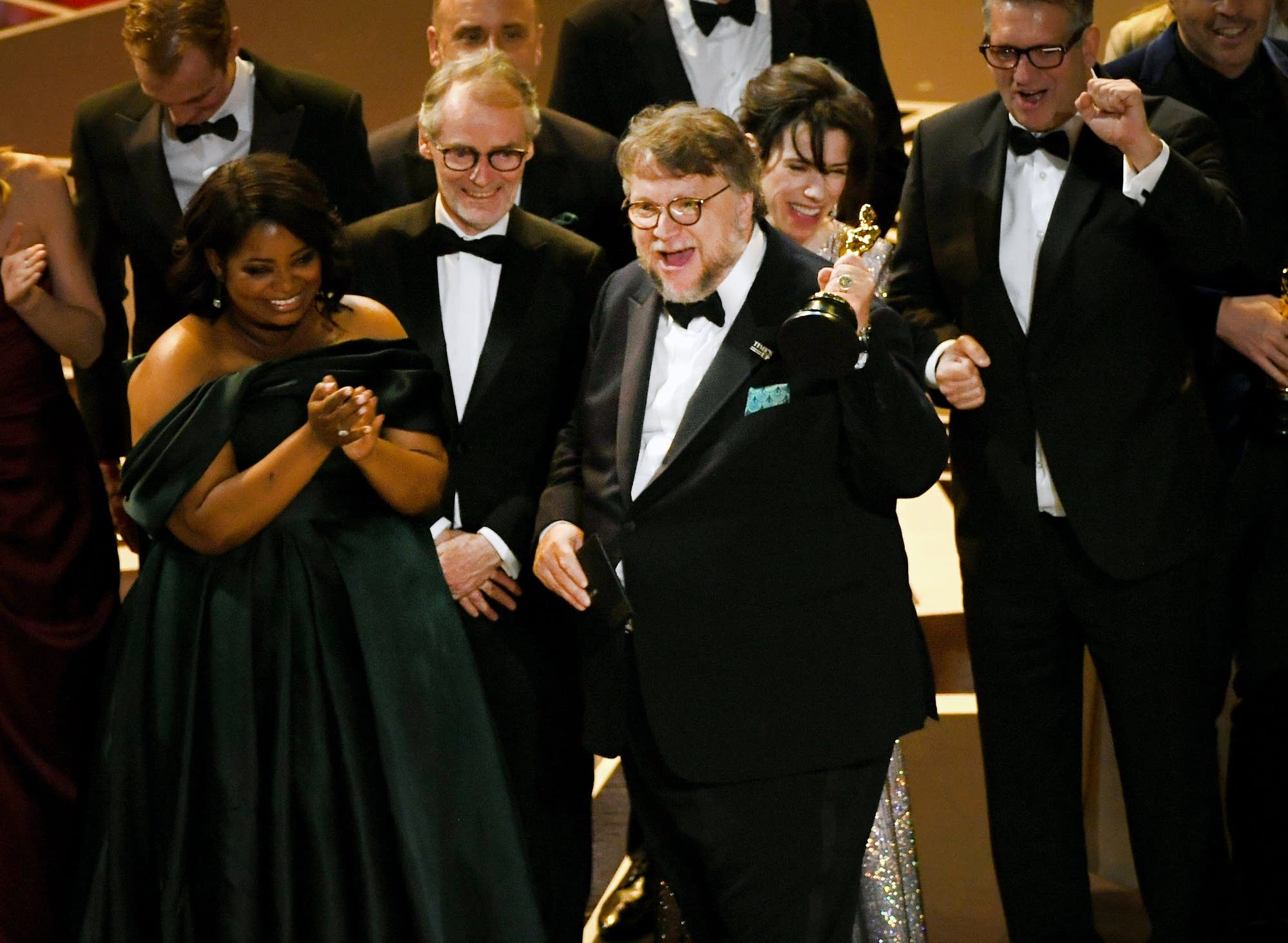 Director Guillermo del Toro holds the best picture Oscar.