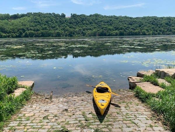 A kayak at the edge of a lake