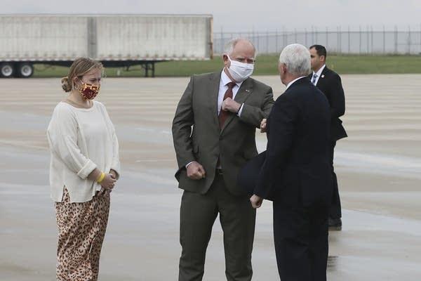 Minnesota Gov. Tim Walz greets Vice President Mike Pence.