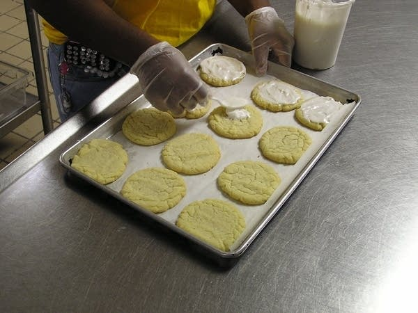Icing cookies at the Cookie Cart Bakery