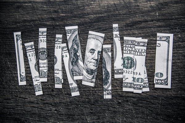A $100 bill cut up.
