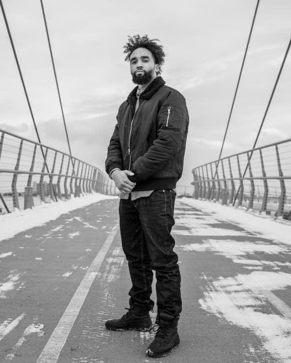 James Badue-El stands for a portrait on the Martin Olav Sabo bridge.