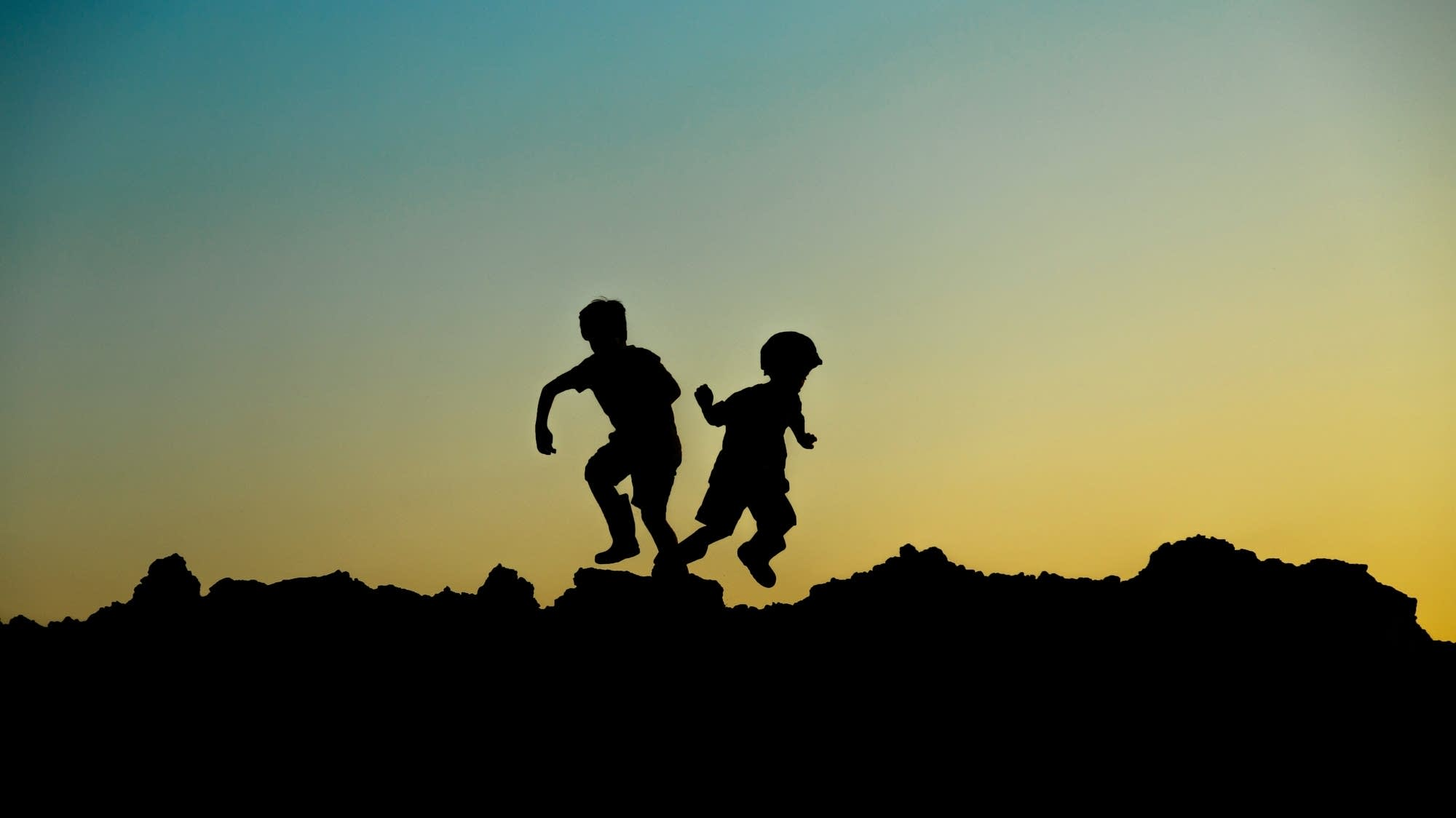 Silhouette of two children