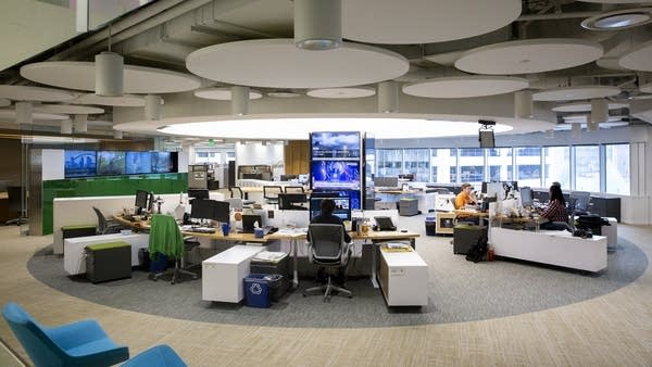 Editors and producers work around a central hub inside the Star Tribune.