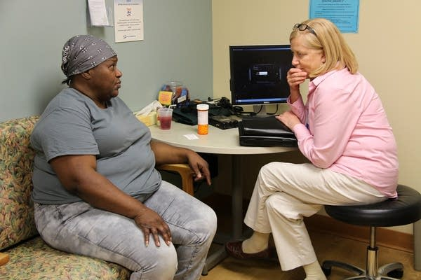 HCMC social worker talked with a patient.