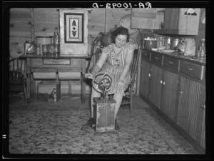 Farmer's wife churning butter. Emmet County, Iowa