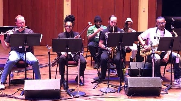 Garrett McQueen rehearses with the wind section of 'Illharmonic.'