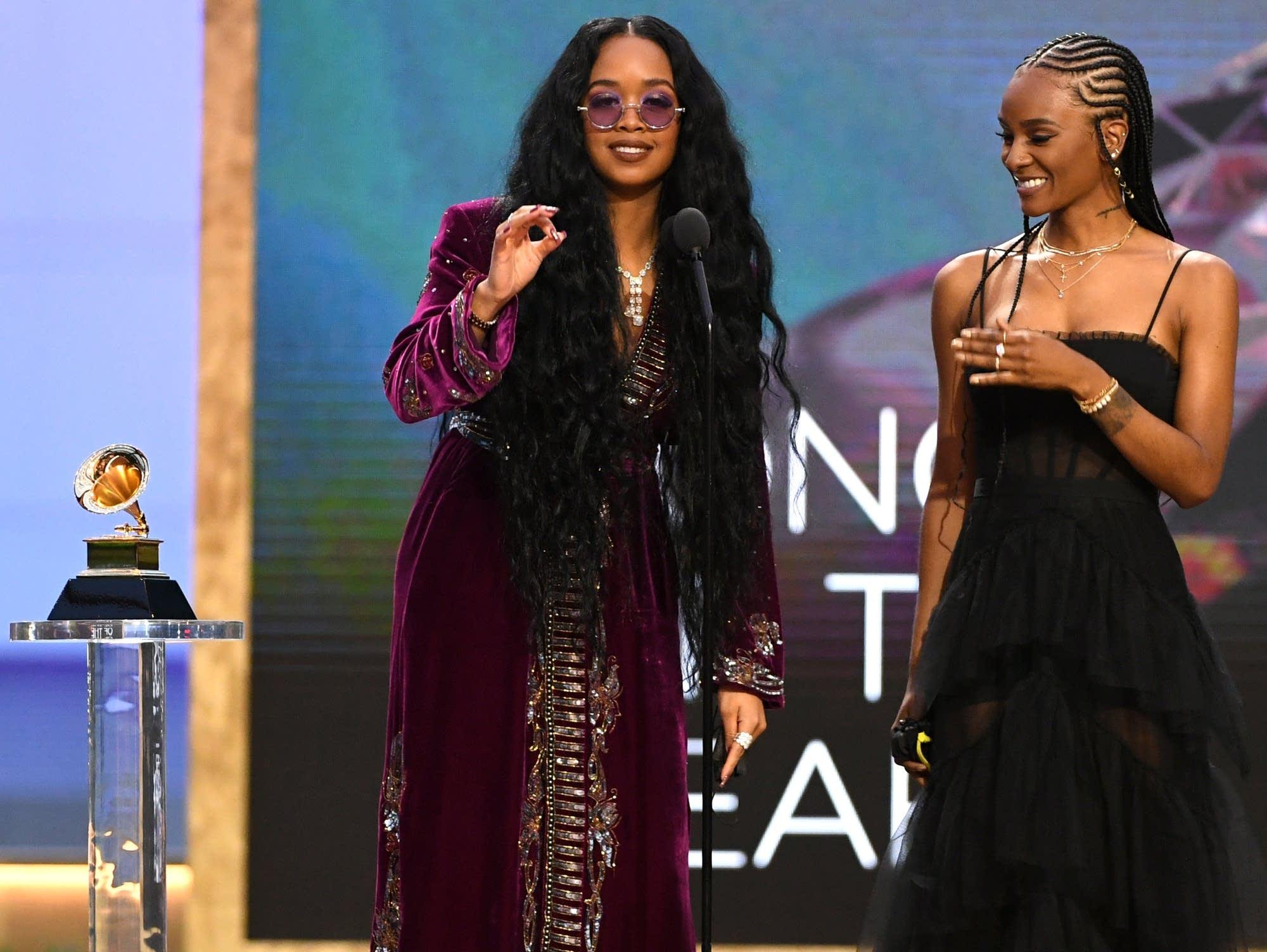 H.E.R. and Tiara Thomas accepting Grammys.