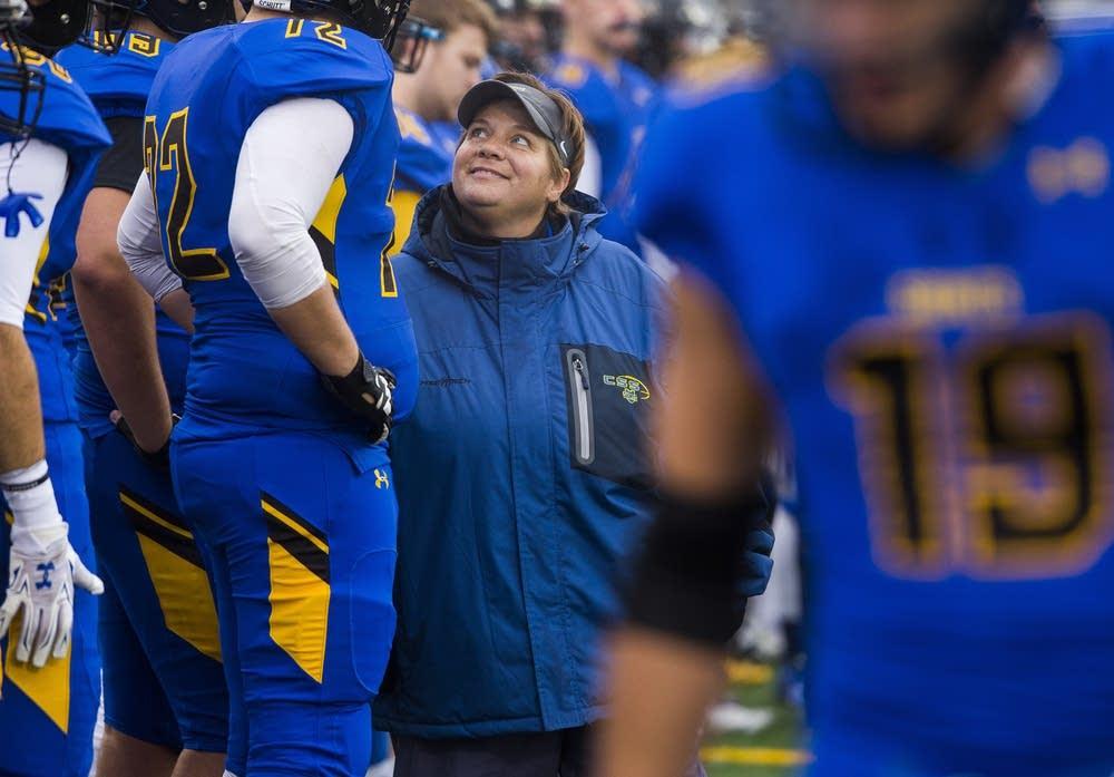 Sister Maurer walks the sidelines.