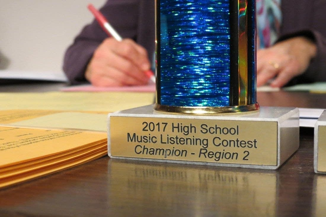 A trophy sits on a table at the Music Listening Contest championship.