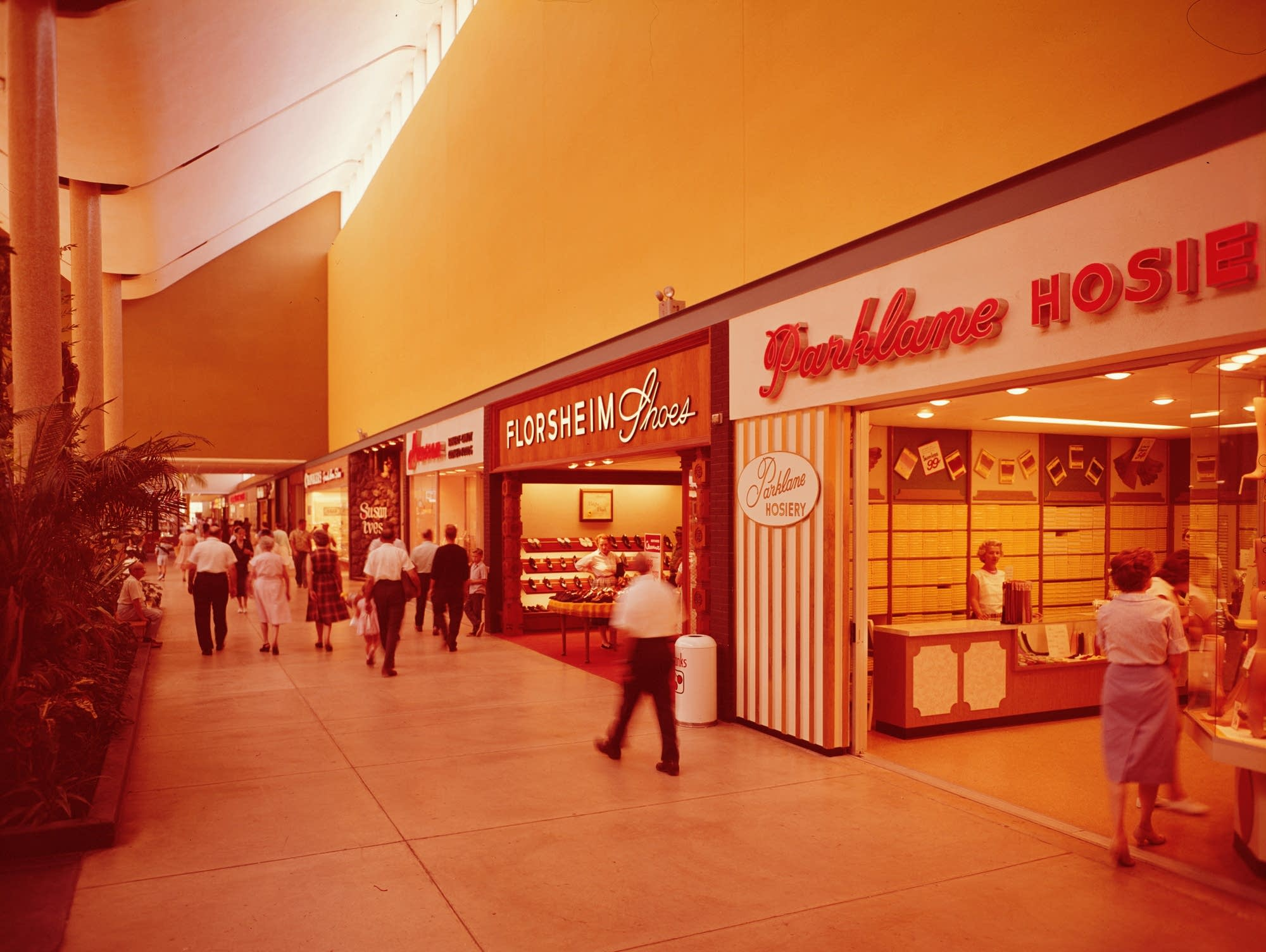 An indoor shopping mall in the 1960s.