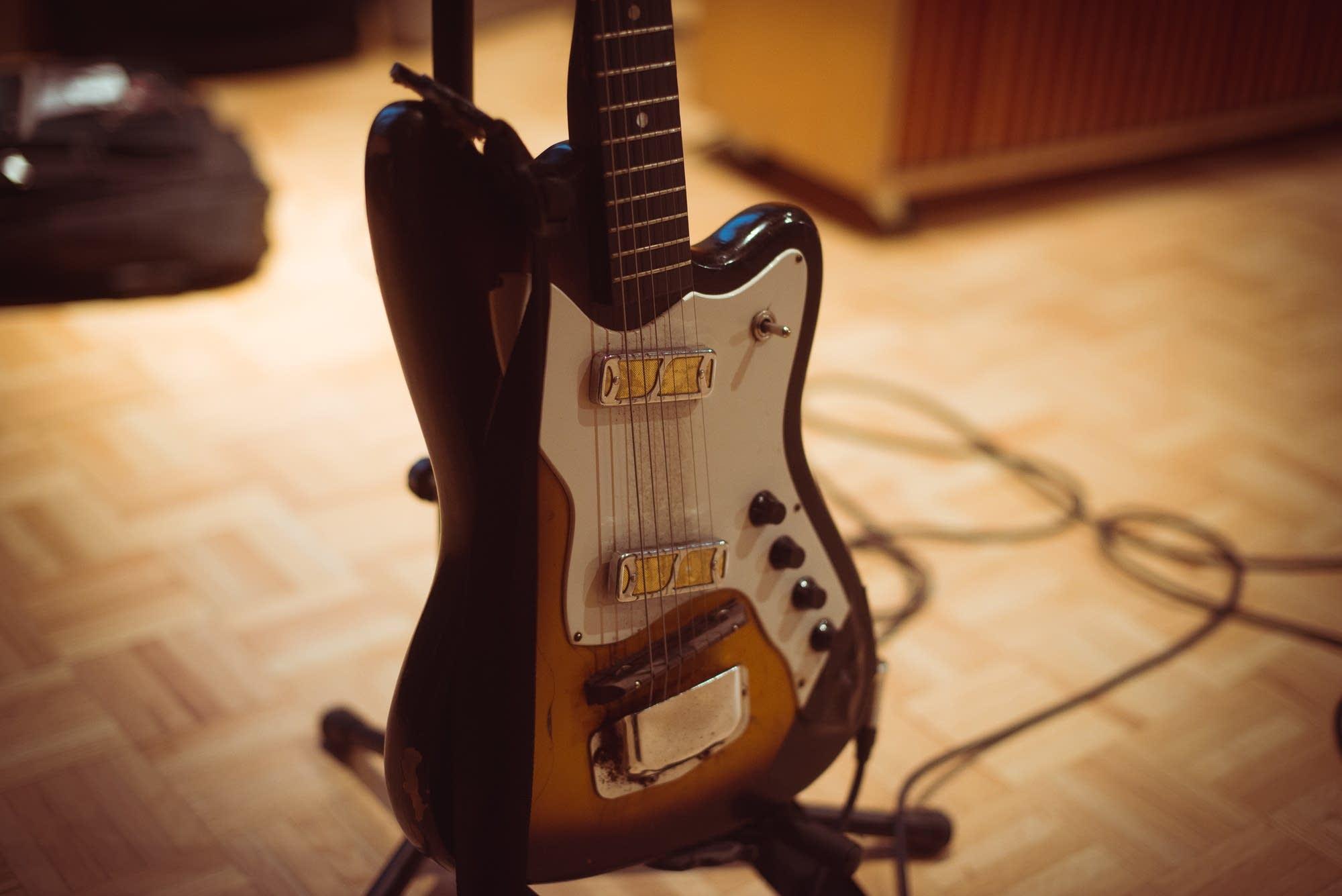 2 Photos Harmony Guitar
