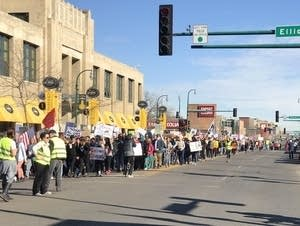 Protesters march in solidarity with immigrants and refugees in Minneapolis
