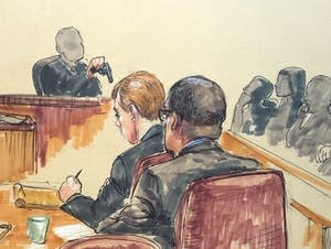An expert witness called by the defense testifies.