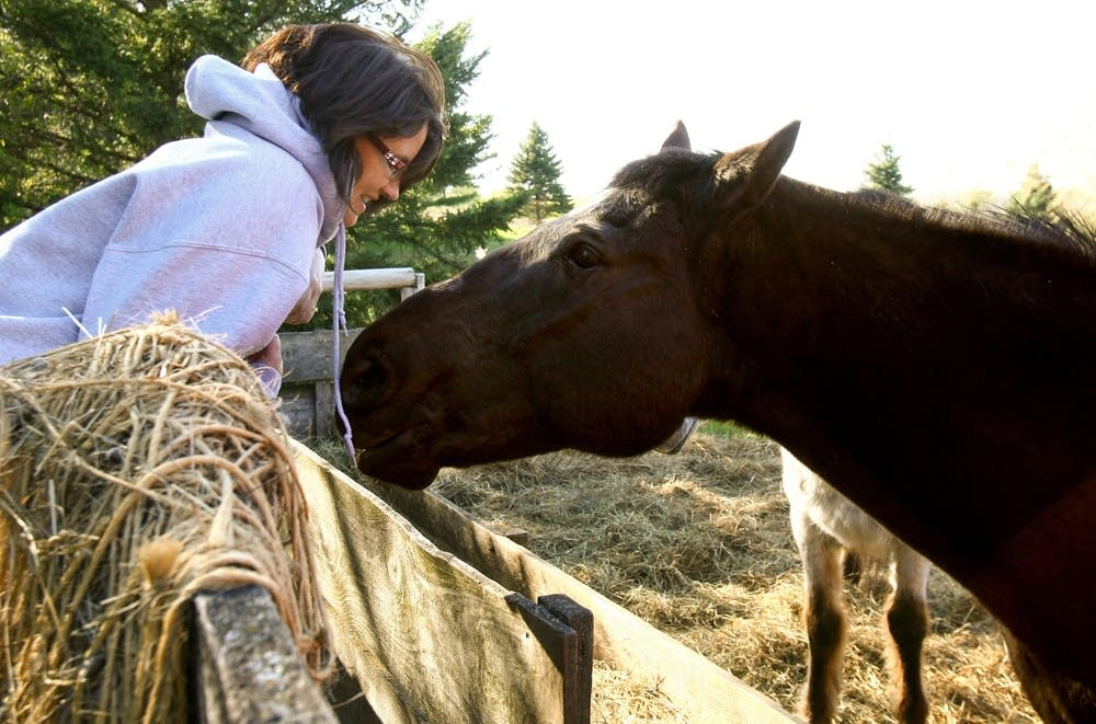 Tina Kerska visits with her horses