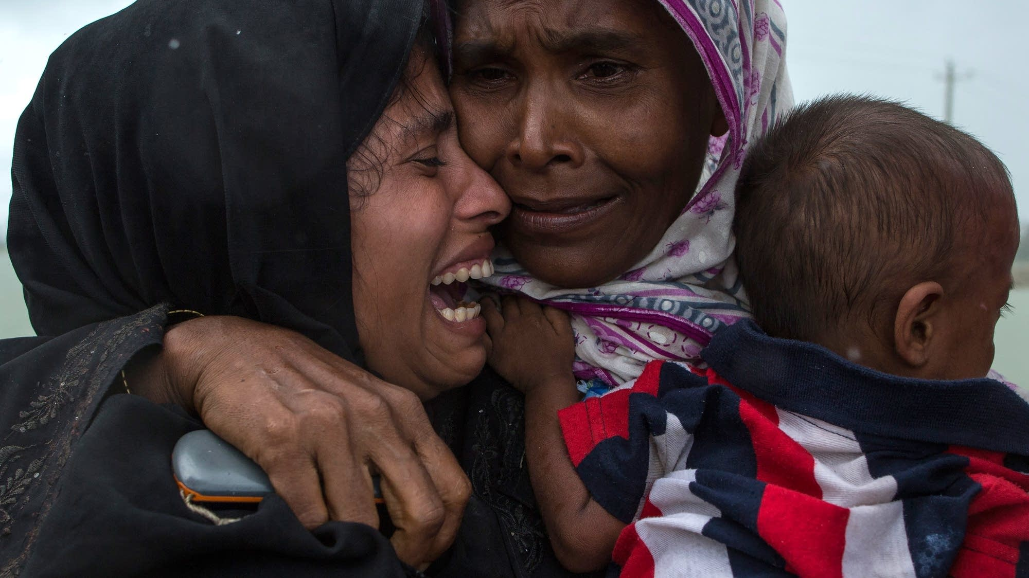 Rohingya refugees embrace one another, finally reunited