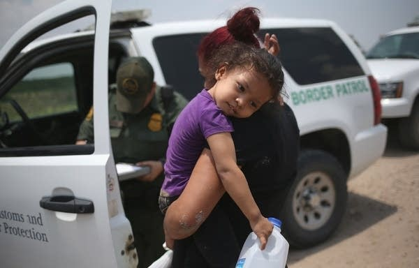 A mother and child, 3, from El Salvador