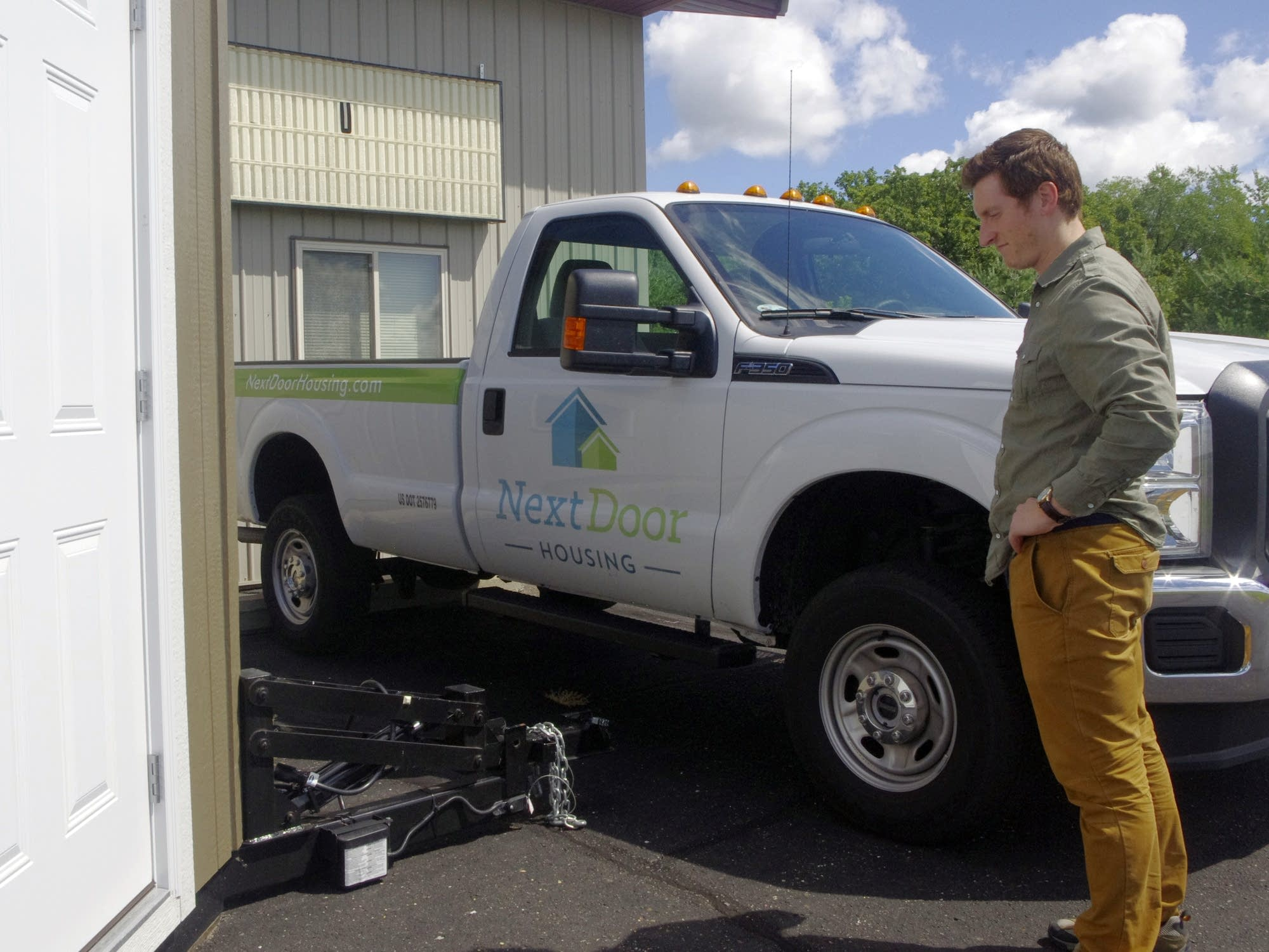 John Louiselle stands by the trailer hitch.